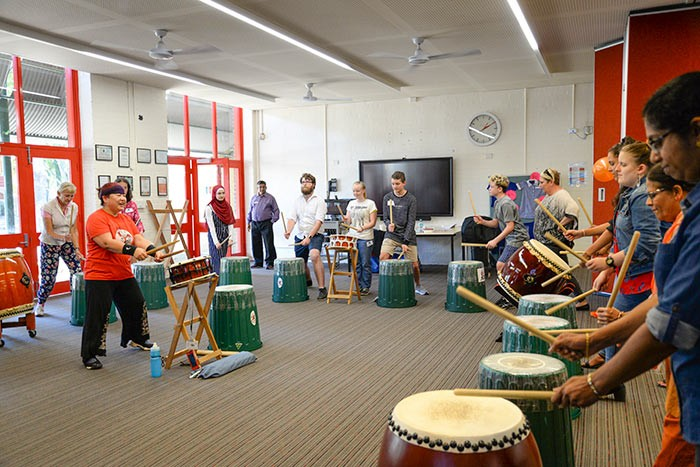 Students and teachers at a drum workshop on Harmony Day.